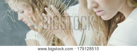 Girl Touching Broken Mirror