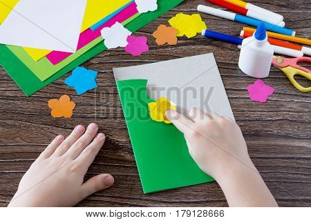 The Child Cuts Out The Details From The Paper. Greeting Card With Flowers On Mother's Day. Children'