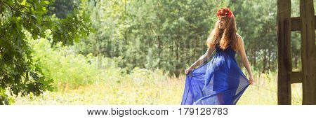 Woman In Blue Dress In The Forest