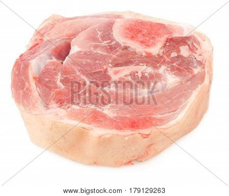 Natural dog food. Slice of raw pork meat with bone and skin isolated on white background.