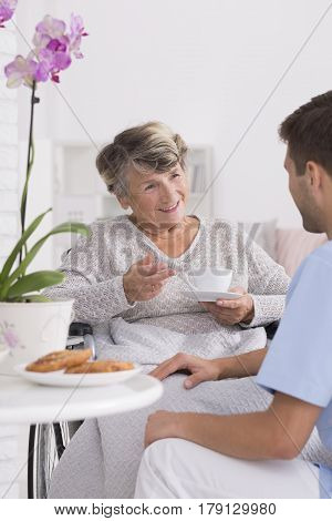 Grandmother Talking With Caregiver