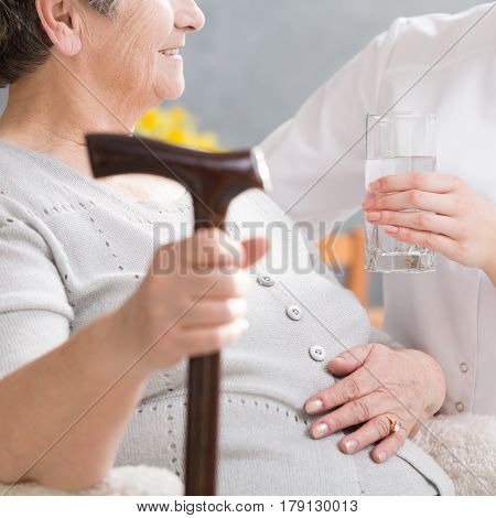 Elderly Disabled Woman And Carer