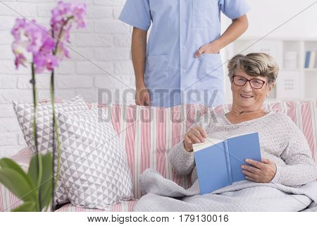 Happy Senior Reading In Retirement Home