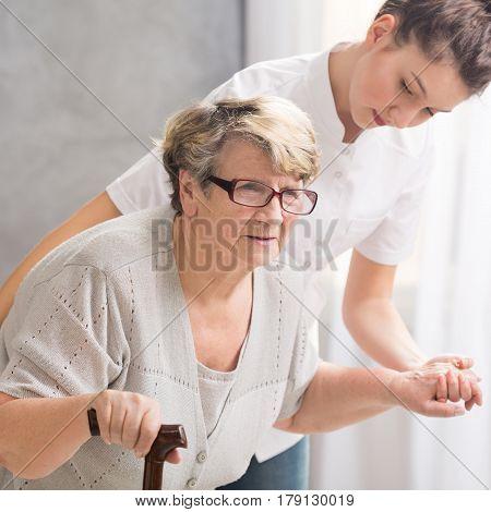 Professional Carer Helping Senior Woman
