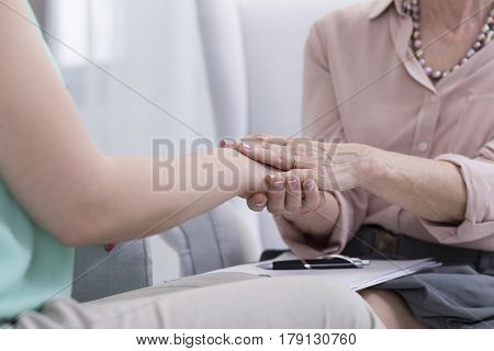 Psychologist Holding Her Patient's Hand