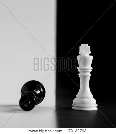 King and Queen chess game pieces on a black and white board