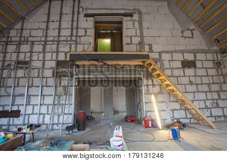 Materials for repairs and tools for remodeling in an apartment that is under construction and renovation during lunch of workers