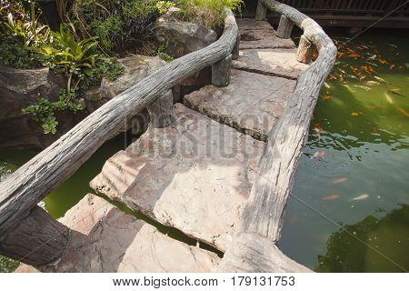 Beautiful Stone bridge in an Asian garden