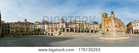 Panoramic view of Plaza Mayor at Trujillo . Saint Martin's church and statue of Fransisco Pisarro. Trujillo. Spain