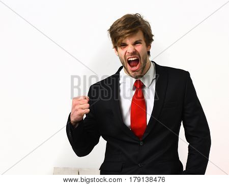 Bearded man short beard. Caucasian stylish shouting business man with moustache in elegant black suit and red tie posing in studio isolated on white background
