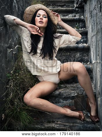 Young Woman Sits On A Concrete  Staircase