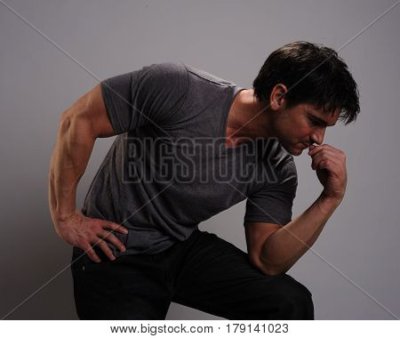 A rugged athlete sits and waits for the big game.
