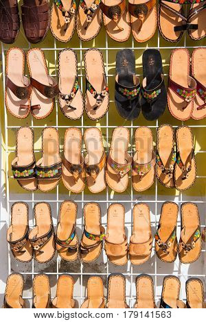 Cozumel Mexico - December 24 2015: leather hand made female slippers flip flops or fashionable summer sandal brown color sale on shop stand or bazaar with nobody in Cozumel Mexico