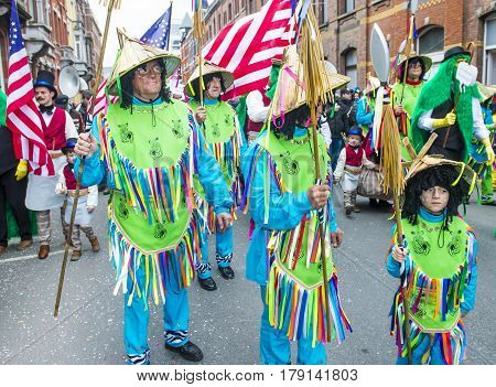 BINCHE BELGIUM - FEB 26 : Participants in the Binche Carnival in Binche Belgium on February 26 2017. The Binche carnival is included in a list of intangible heritage by UNESCO.