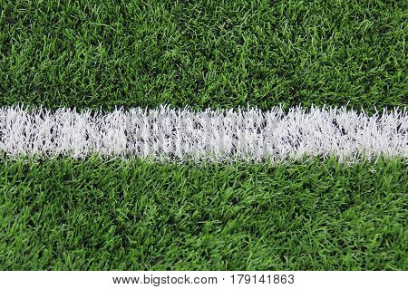 Artificial turf with markings on a football field. Sports background.