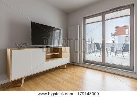 Tv Living Room With Balcony