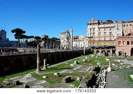 Trajan's Forum with churches Santa Maria di Loreto and Santissimo Nome di Maria al Foro Traiano on the background in Rome