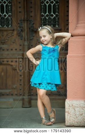 Small Baby Girl With Happy Face In Blue Dress Outdoor