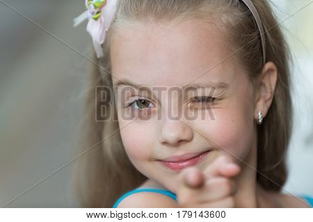 Small Baby Girl With Smiling Face Winking Outdoor