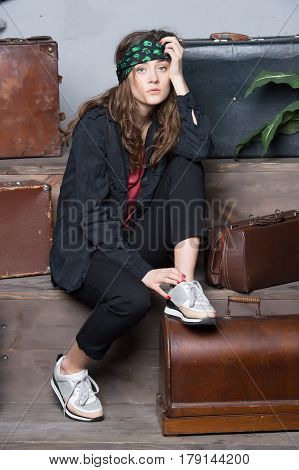 Pretty Woman In Bandana Near Travel Suitcase And Bag