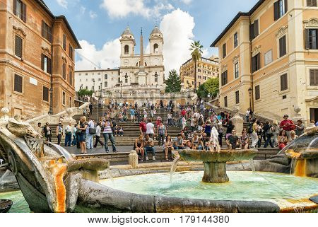 ROME, ITALY - CIRCA OCTOBER 2012: The Spanish Steps seen from Spanish square (Piazza di Spagna). Fountain of the Ugly Boat by Bernini in the foreground. The Spanish Steps are the widest staircase in Europe.