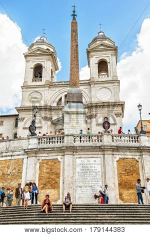 ROME, ITALY - CIRCA OCTOBER 2012: Santissima Trinita dei Monti church and ancient obelisk at the top of the Spanish steps.