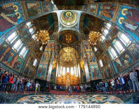 ST PETERSBURG, RUSSIA - JUNE 13, 2014: Tourists in Church of the Savior on Spilled Blood (Cathedral of the Resurrection of Christ). It is an architectural landmark of St Petersburg and a unique monument to Alexander II the Liberator.