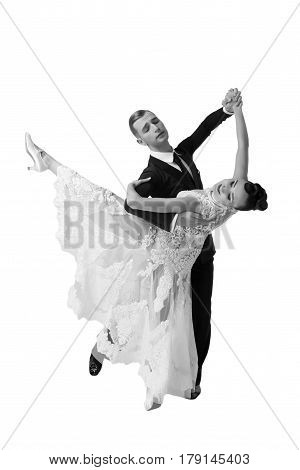 beautiful ballroom dance couple in a dance pose isolated on white background. sensual professional dancers dancing walz tango slowfox and quickstep black and white