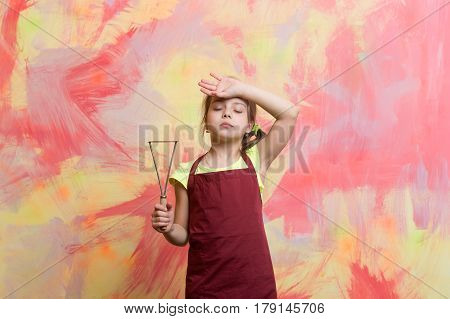 Small Tired Girl Chef In Cook Apron Holding Cooking Tool
