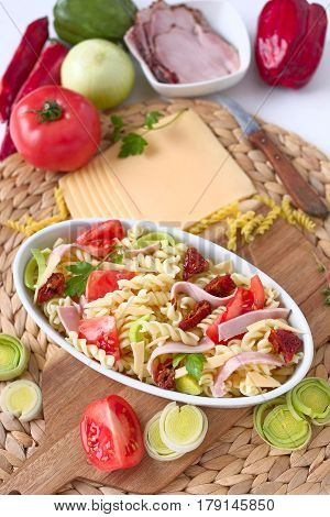 Pasta gratin with ham and vegetable and ingredient.