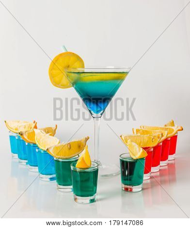 Eleven Color Shot Drinks, Red, Blue And Green Kamikaze, Drink In Martini Glass, Quarters Of Lemon