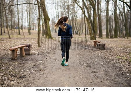 Healthy Lifestyle Fitness Sporty Woman Runner Running In Forest Trail. Health Concept