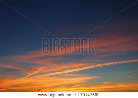 Colorful evening skyscape. Evening gradient sky from blue to yellow color. Evening sky background.