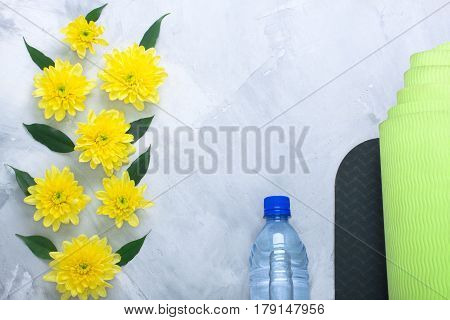 Summer Spring Flatlay Composition Yoga Mat And Bottle Of Water