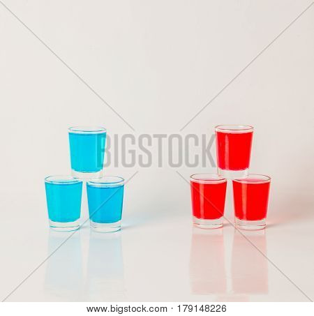 Glasses With Blue And Red Kamikaze, Glamorous Drinks, Mixed Drink Poured Into Shot Glasses