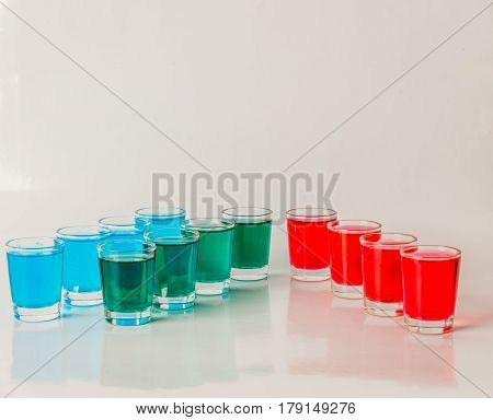 Glasses With Blue, Green And Red Kamikaze, Glamorous Drinks, Mixed Drink Poured Into Shot Glasses