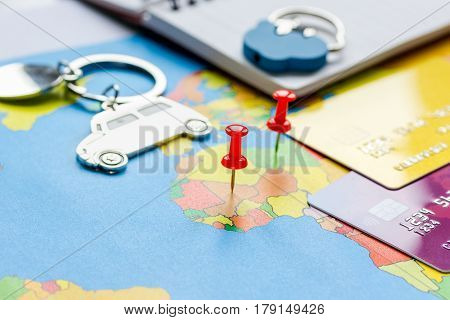 Travel preparation and booking car with credit cards on touristic map background