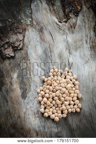 Spilled Chickpeas On A Rustic Wooden
