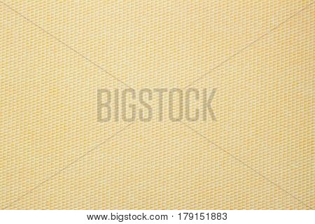 Texture of paper with an unusual structure in small cell monochromatic warm beige shades for artwork. Background , backdrop, substrate, composition use for design, copy space for text or image.
