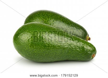 Pair of green ripe avocado on white background