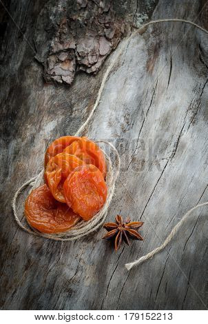 Dried Apricots On Aged Wood With Twine