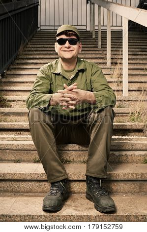 Soldier on sentry duty smiling on building stairs