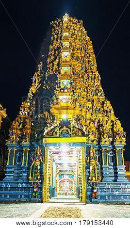 The Gopuram Tower of Tamil Hindu Temple - Muthumariamman Kovil decorated with numerous sculptures Matale Sri Lanka.