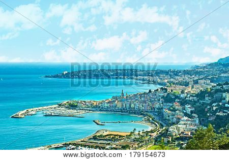 The aerial view of French riviera pearles - Menton with it's port beaches colorful houses and bell towers of old town and the Roquebrune-Cap-Martin on the background France.