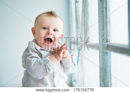 Portrait of happy joyful beautiful little boy.