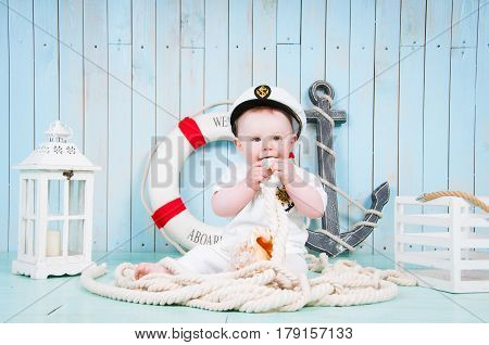 A small cheerful captain in a maritime interior.