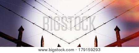 Escape concept - prison fence in barbed wire fence closeup - security anti-escape concept
