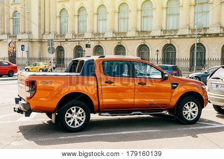 BUCHAREST ROMANIA - APR 1 2016: Beautiful and powerful orange Ford Ranger (codenamed T6) Wildtrack parked in center of Bucharest. Ford Wildtrack is a midsize pickup truck produced by Ford Motor Company.