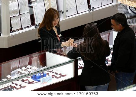 Burnaby, BC, Canada - March 07, 2017 : Top shot of people shopping jewelry inside Burnaby shopping mall