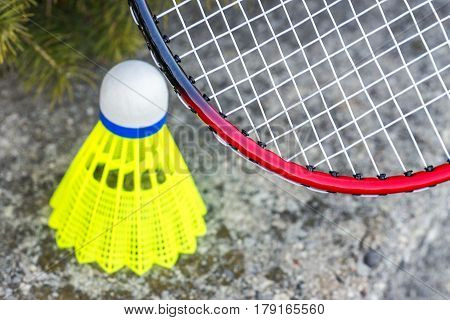 Closeup of badminton rachet and neon yellow shuttlecock sports and recreational activity background